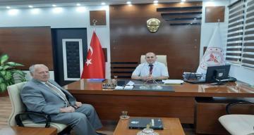 İl Genel Meclis Üyesi Bekir Yıldız Dr.Öğr.Üyesi Orhan ÇİMEN'i makamında ziyaret etti