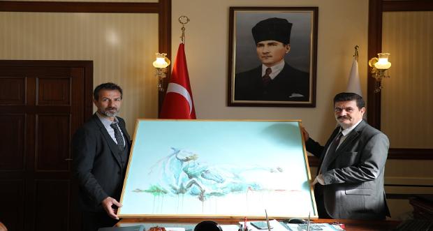 Uluslararası Erzincan Tarihi Sempozyumu'nun Düzenleme Kurulu Heyeti, Erzincan Valisi Ali Arslantaş'ı makamında ziyaret ettiler